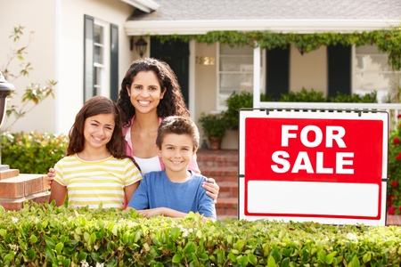 buying a house: Mother and children outside home for rent Stock Photo