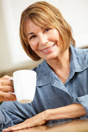 Mid age woman drinking coffee photo