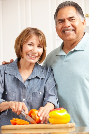 overweight man: Senior couple cooking Stock Photo