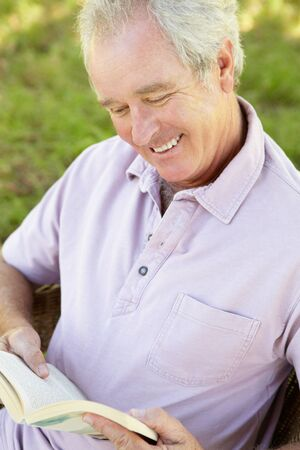 Senior man reading a book photo