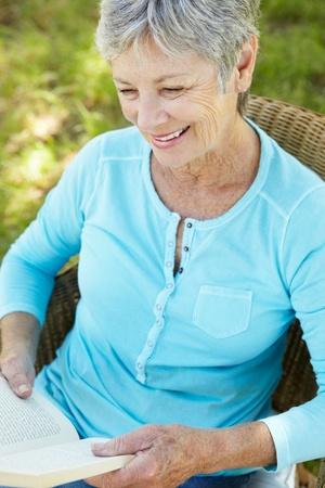 Senior woman reading a book Stock Photo - 11239081