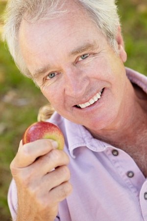 Senior man eating apple Stock Photo - 11239017