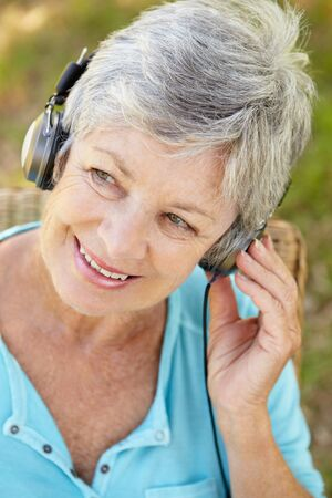 Senior woman with headphone Stock Photo - 11239105