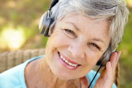 Senior woman with headphone Stock Photo - 11239076