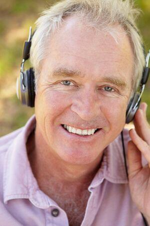 Senior man with headphone Stock Photo - 11239027