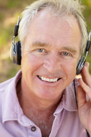 Senior man with headphone Stock Photo - 11239027