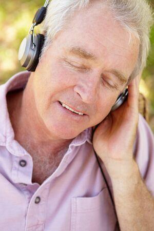 Senior man with headphone Stock Photo - 11239019