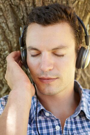 Young man listening music Stock Photo - 11239014