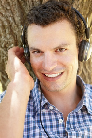 gray haired: Young man listening music
