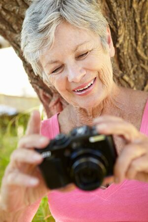 Senior woman with camera Stock Photo - 11239075