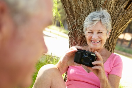 season photos: Senior woman with camera