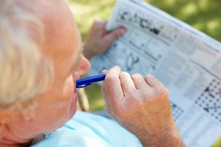 brain aging: Senior man with newspaper