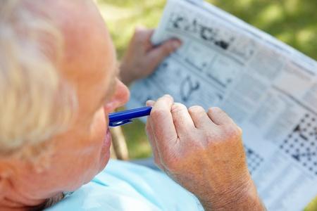 aging brain: Senior man with newspaper