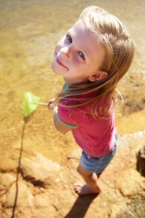 6 7: Happy girl fishing