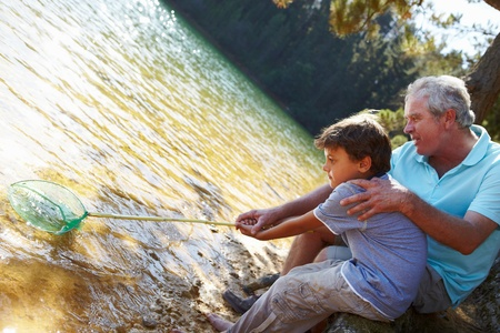 Man and boy fishing together Stock Photo - 11239110