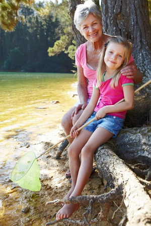 Woman and girl fishing together Stock Photo - 11239072