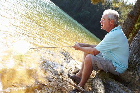 Senior man fishing at lake Stock Photo - 11239111