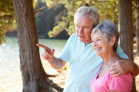 Senior couple at lake together photo