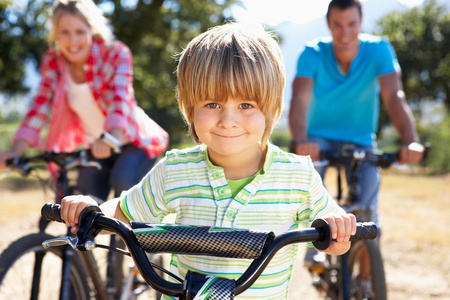 family exercise: Young family on country bike ride Stock Photo
