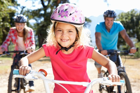 riding bike: Young family on country bike ride Stock Photo