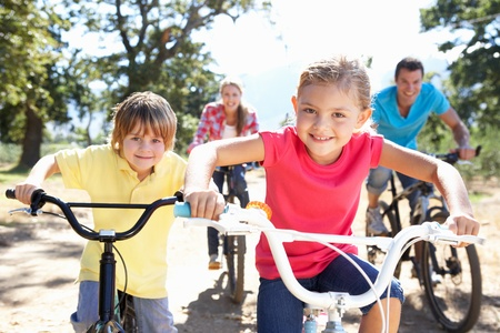 family bike: Young family on country bike ride Stock Photo