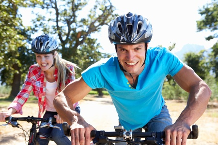 Young couple on country bike ride photo