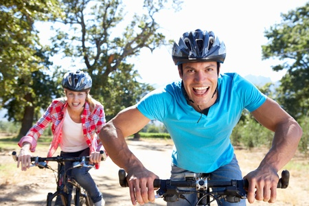 bike race: Young couple on country bike ride