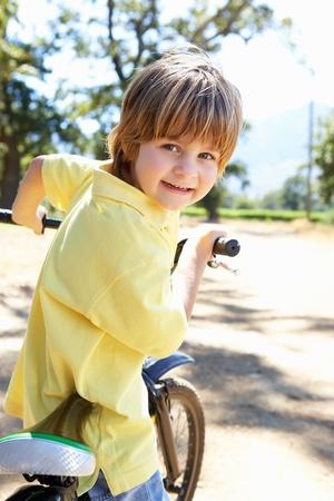 Little boy on country bike ride photo