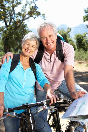 senior reading: Senior couple with map on country bike ride Stock Photo