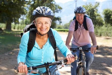 senior fitness: Senior couple on country bike ride