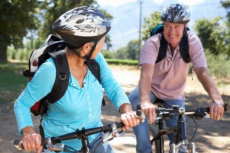 Senior couple on country bike ride photo