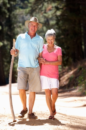 guy with walking stick: Senior couple on country walk Stock Photo