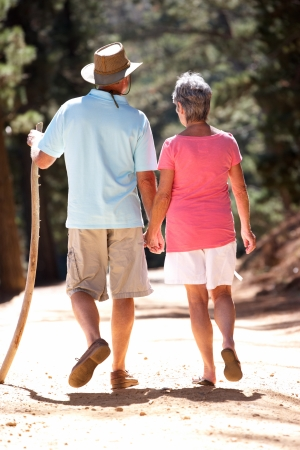 older couples: Senior couple on country walk Stock Photo