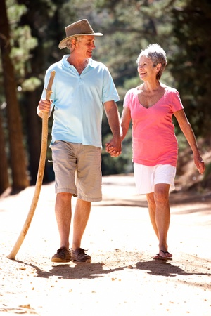 elderly couples: Senior couple on country walk Stock Photo