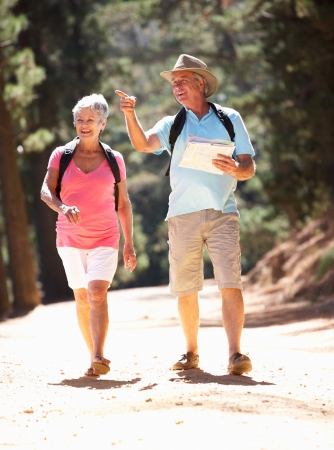 rambling: Senior couple on country walk Stock Photo
