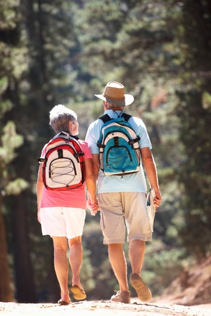 rambling: Senior couple on country walk Stock Photo