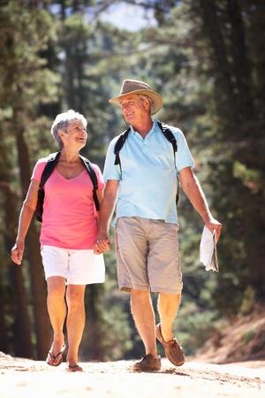 country lifestyle: Senior couple on country walk Stock Photo