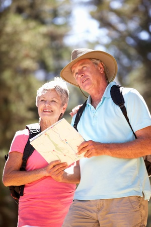 active seniors: Senior couple reading map on country walk Stock Photo