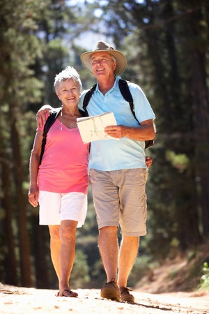retired: Senior couple reading map on country walk Stock Photo