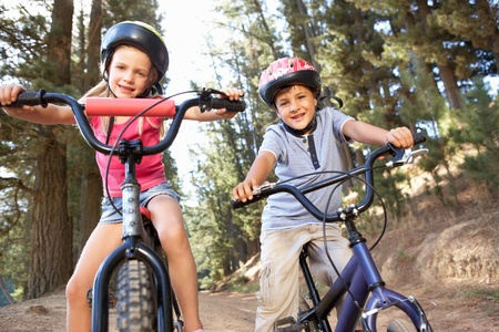 Young children on bikes in country photo