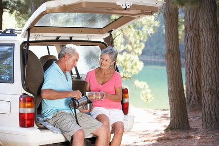 Senior couple on country picnic photo