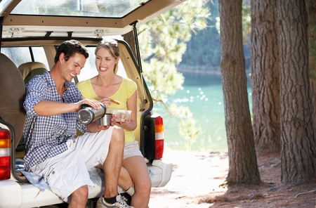 drink and drive: Young couple on country picnic