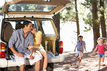 river trunk: Young family on day out in country Stock Photo