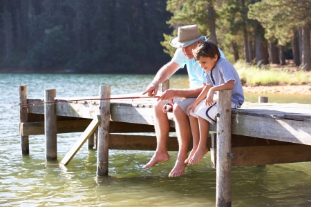 grandfather and grandson: Senior man fishing with grandson