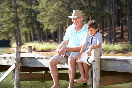 grandad: Senior man fishing with grandson