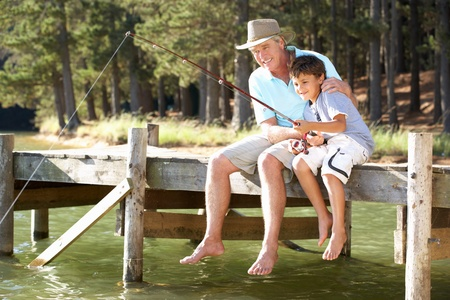 6 year old: Senior man fishing with grandson