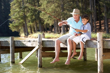 a year older: Senior man fishing with grandson