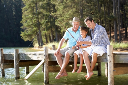 Father,son and grandson fishing together photo