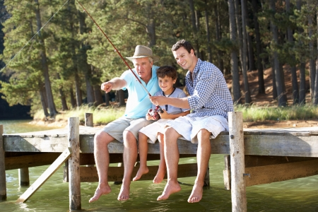 Father,son and grandson fishing together Stock Photo