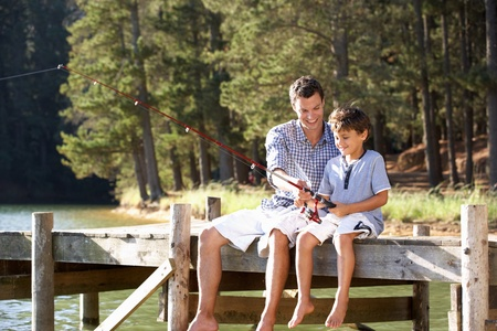 angling: Father and son fishing together Stock Photo